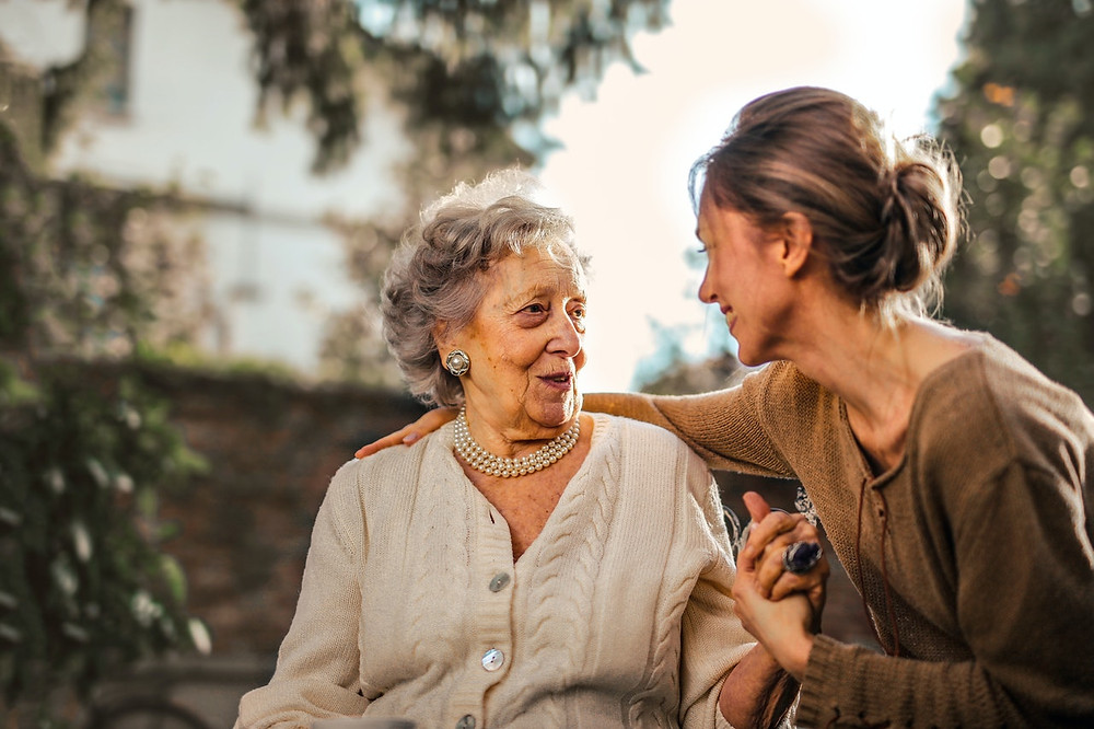 Picture of older woman talking to a younger woman. Possibly Mother and daughter.