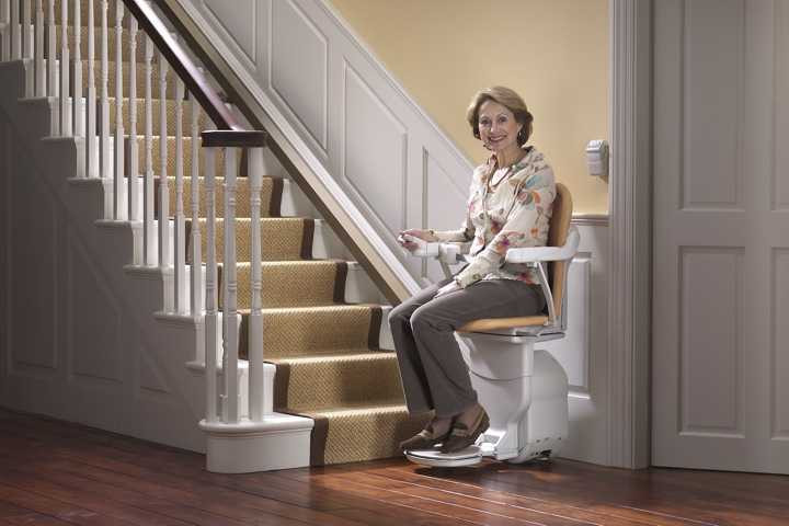 Woman using stairlift