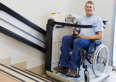 Man in wheelchair using stairlift