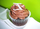 Chocolate Butter Cream Cupcake, Chocolate chuncks baked in a moist rich cupcake