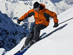 Down hill skiing on a mountain side