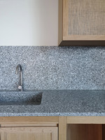kitchen counter, sink, wall cover