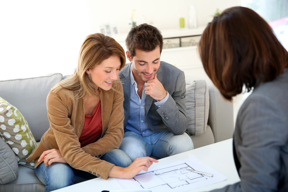 Interior designer and client working together.
