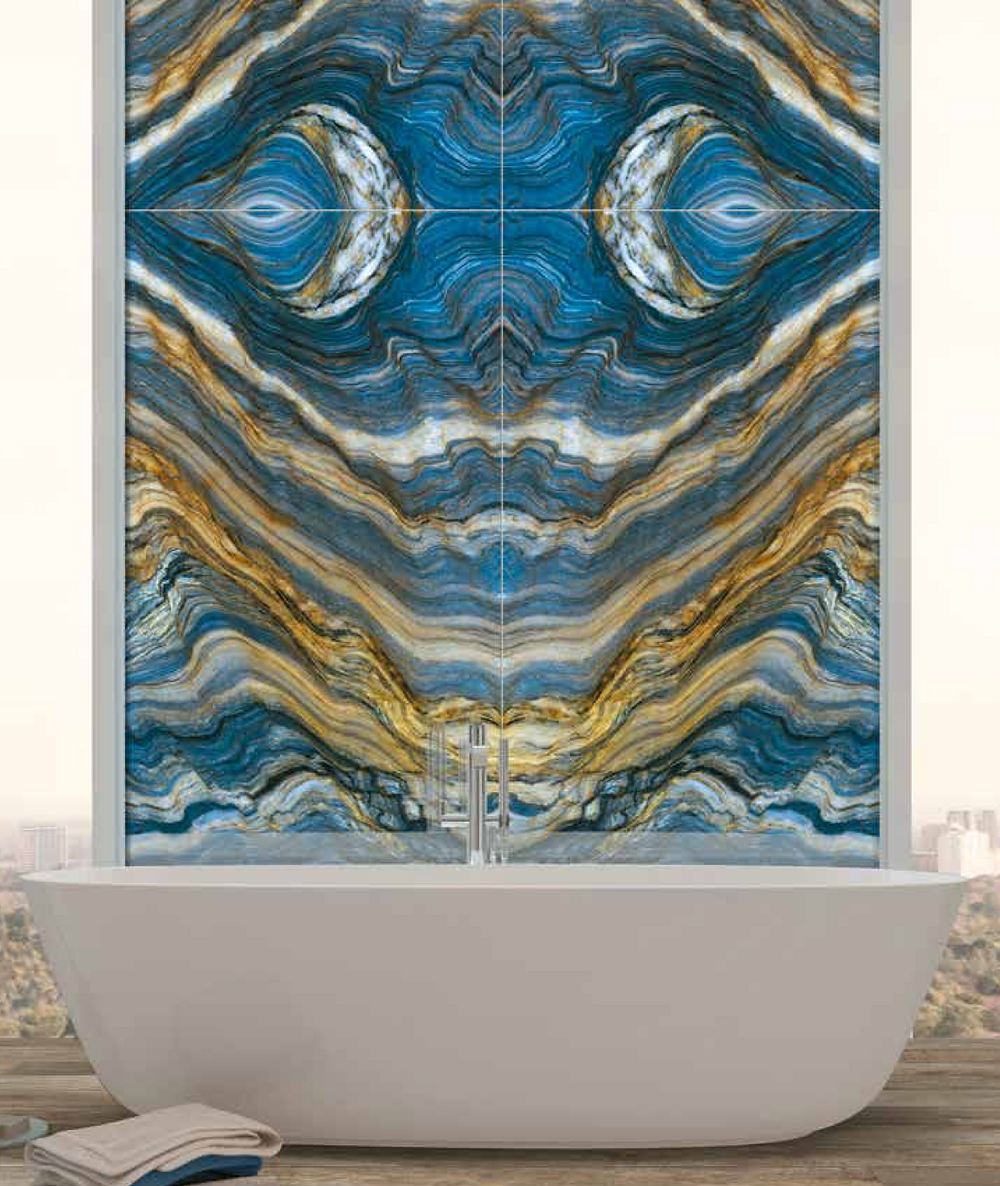 Large format book matched porcelain tiles for use in bathrooms.