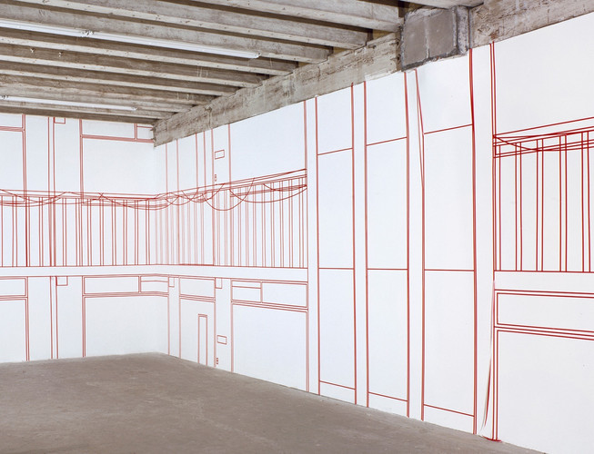 Mural in red on two walls in Consortium