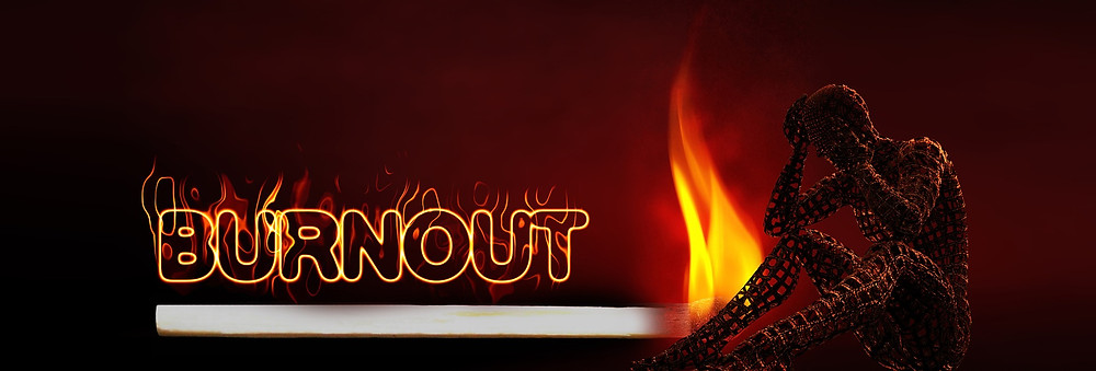 Neon signage saying Burnot with lighted match