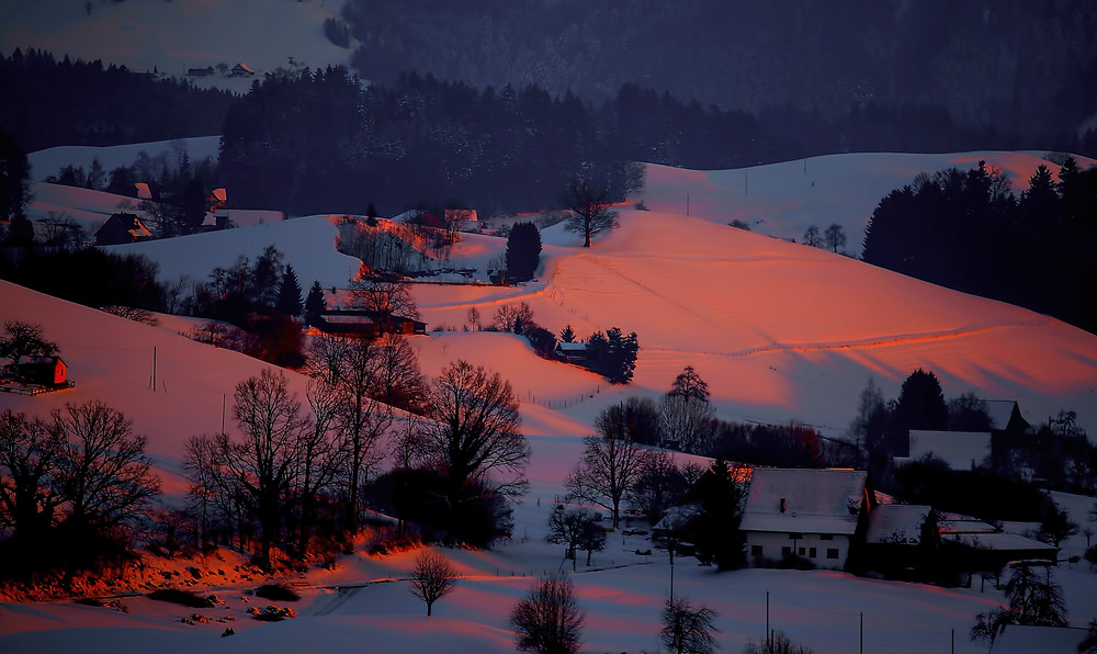 Snow covered town at sunset