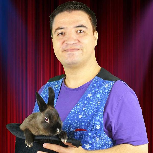 javier arrillaga magician holding rabbit