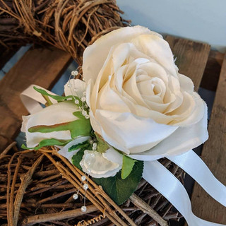 Artificial rose on ribbon.