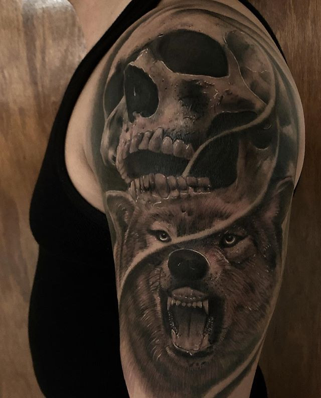 Done with this wolf and skull tattoo.jpg