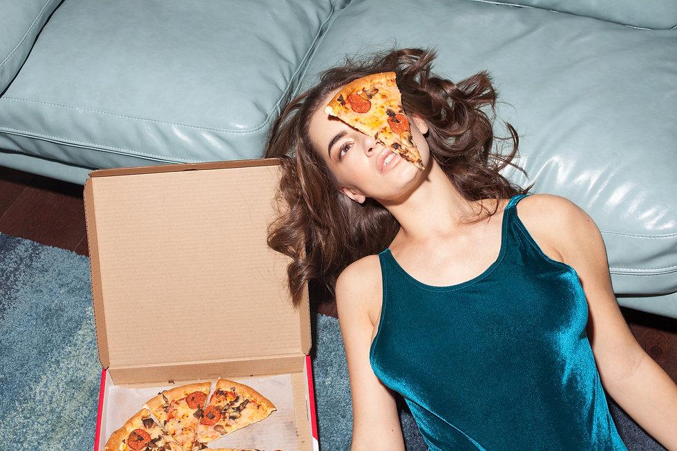 iStock-877877250 pizza on face 1.jpg