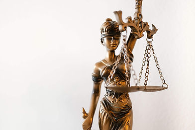 blind-lady-justice-statue-in-law-office-