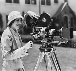 Woman using movie camera outdoors.jpg