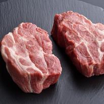 Two fresh raw boneless pork shoulder but
