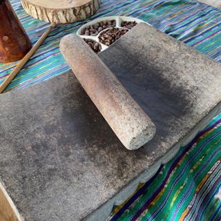 Grinding chocolate on the metate.jpeg