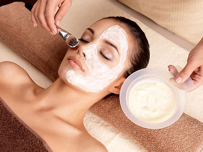 Esthetician Applying Face mask to Woman