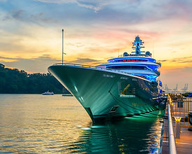 Docked green yacht at sunset in Singapor