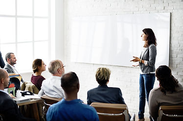 Certified trainer with an audience from a business
