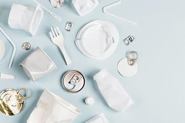 White single use plastic on  blue backgr