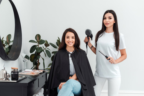 smiling-client-sits-hairdresser-s-chair-