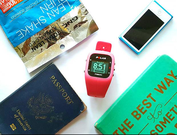 fitness travel snacks protein powder passport and polar watch