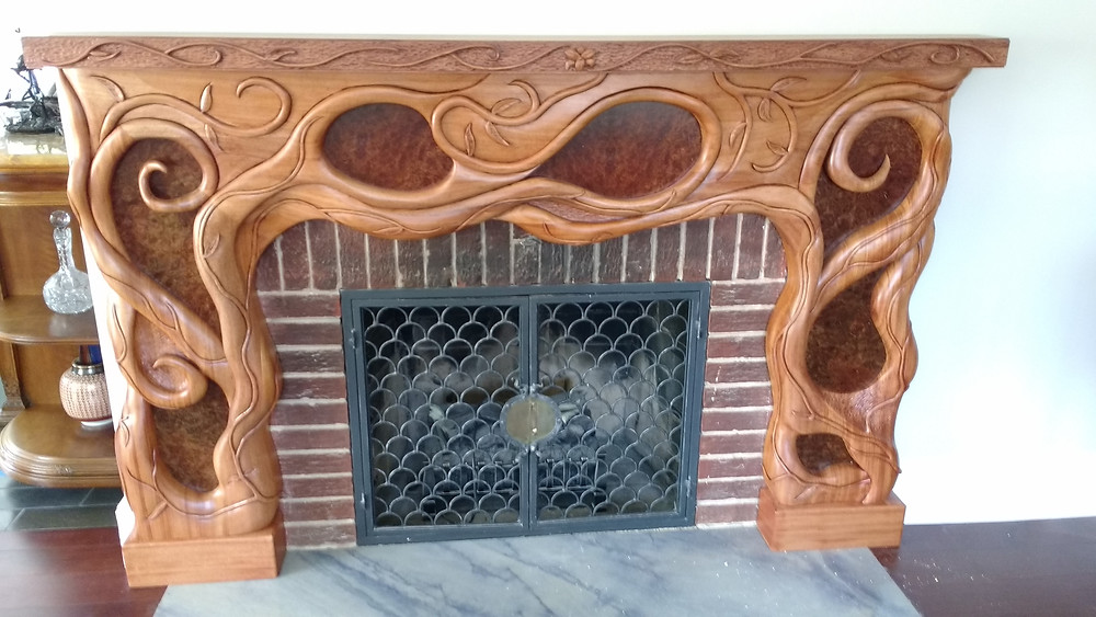Hand carved Mahogany mantle with Carpatian Elm panels
