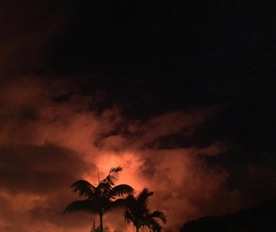 After-sunset glow from Mount Kilauea's lava flowing into the ocean