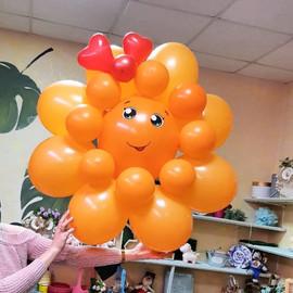 Солнце из шаров оранжевого цвета
