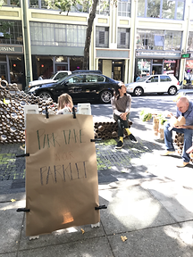 Some sidewalk signage to promote interaction with the Parklet