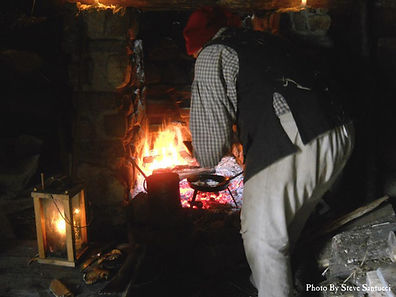 Tending the hearth in the huts during the 18th century
