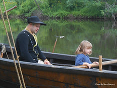 Father and daughter in an 18th century boat at the Red Mill in Clinton New Jersey