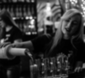 Kavatender Bartender pours shots of exotic kraom tea into shot glasses at Dharma Hookah Kava Lounge