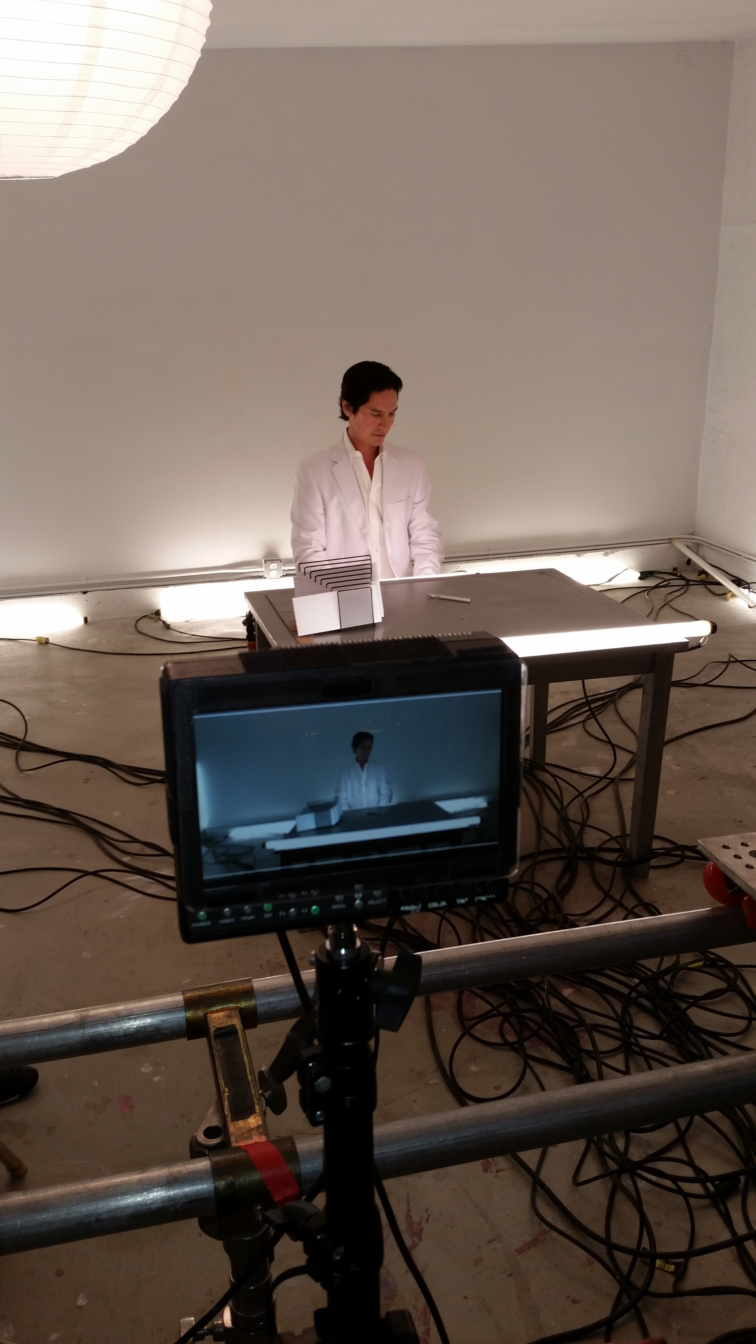 Michael Teh prepares on the set