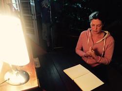 Paige White prepares on set