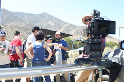 Cast and Crew pause in between takes