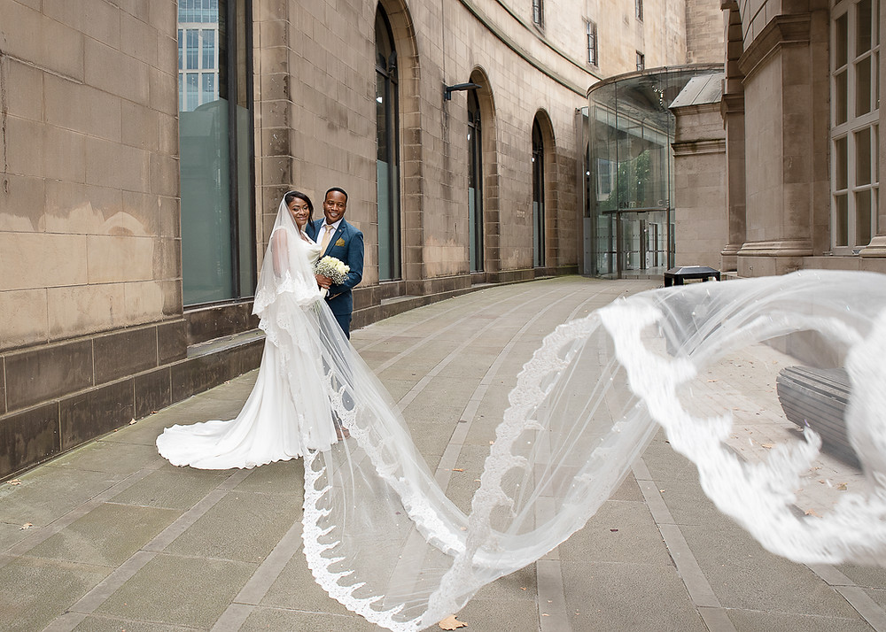 wedding street photo with big vail in Manchester