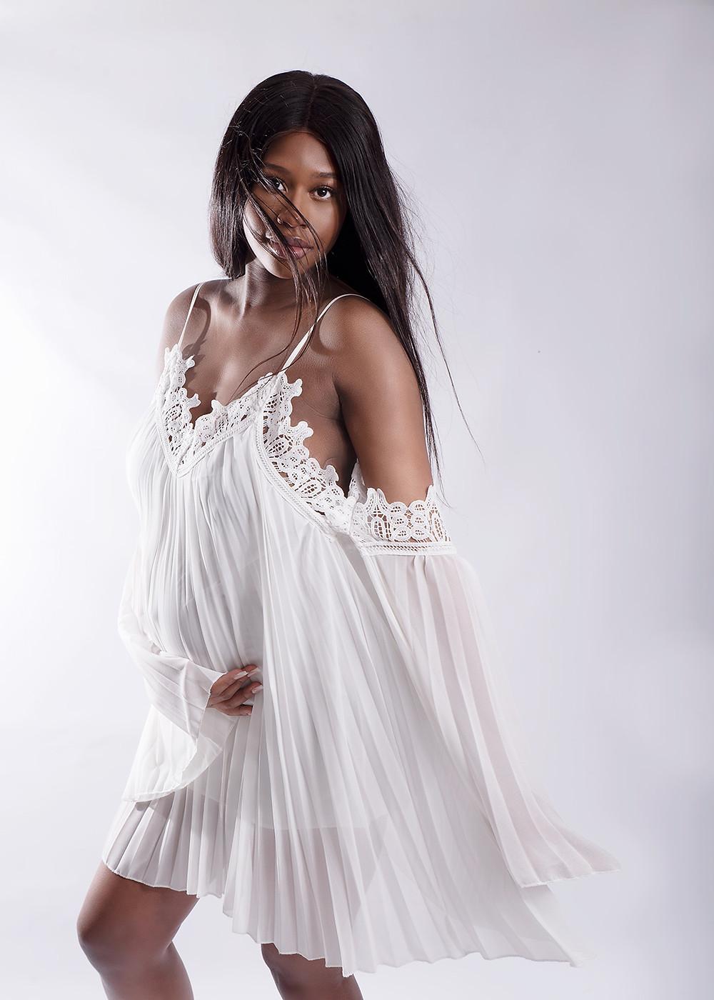 Pregnancy portrait in white maternity dress