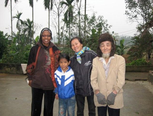 Assata with Vietnamese Family