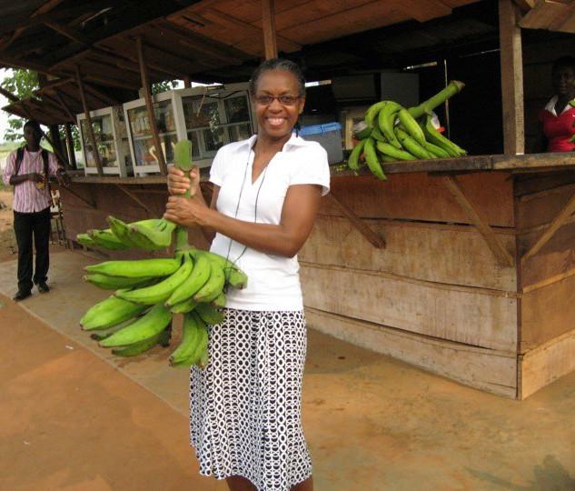 Assata with banana's in Ghana