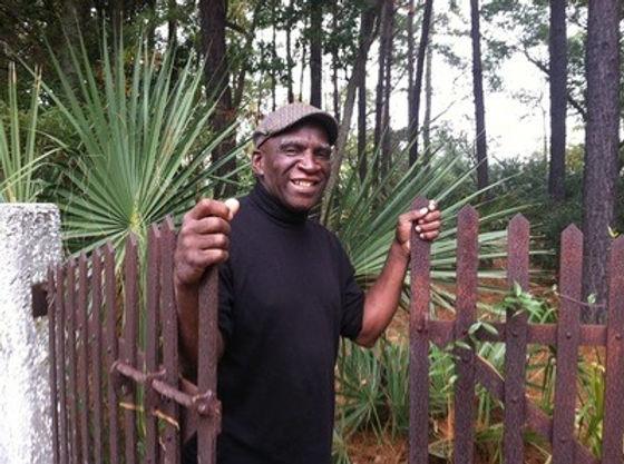 Dr. Ade smiling at gate.jpg