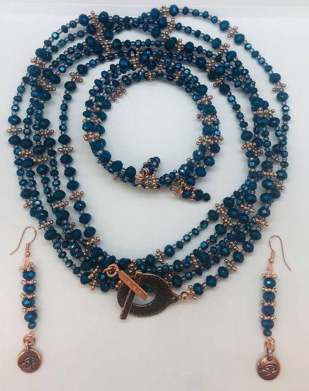 Blue necklace earrings bracelet.jpg