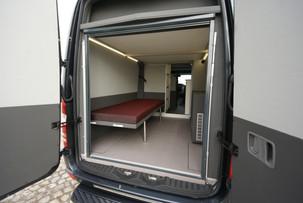 Sklopená postel v garáži