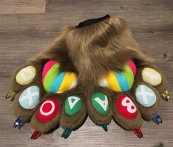 A super unique pair of paws for _koko_pengyou ! They have appliquéd letters on the toe-pads, multico