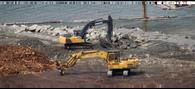 excavators-at-log-sorting-site.png