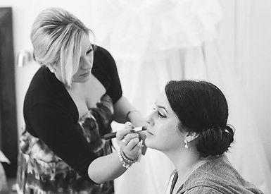 Lizzy Westney applying makeup