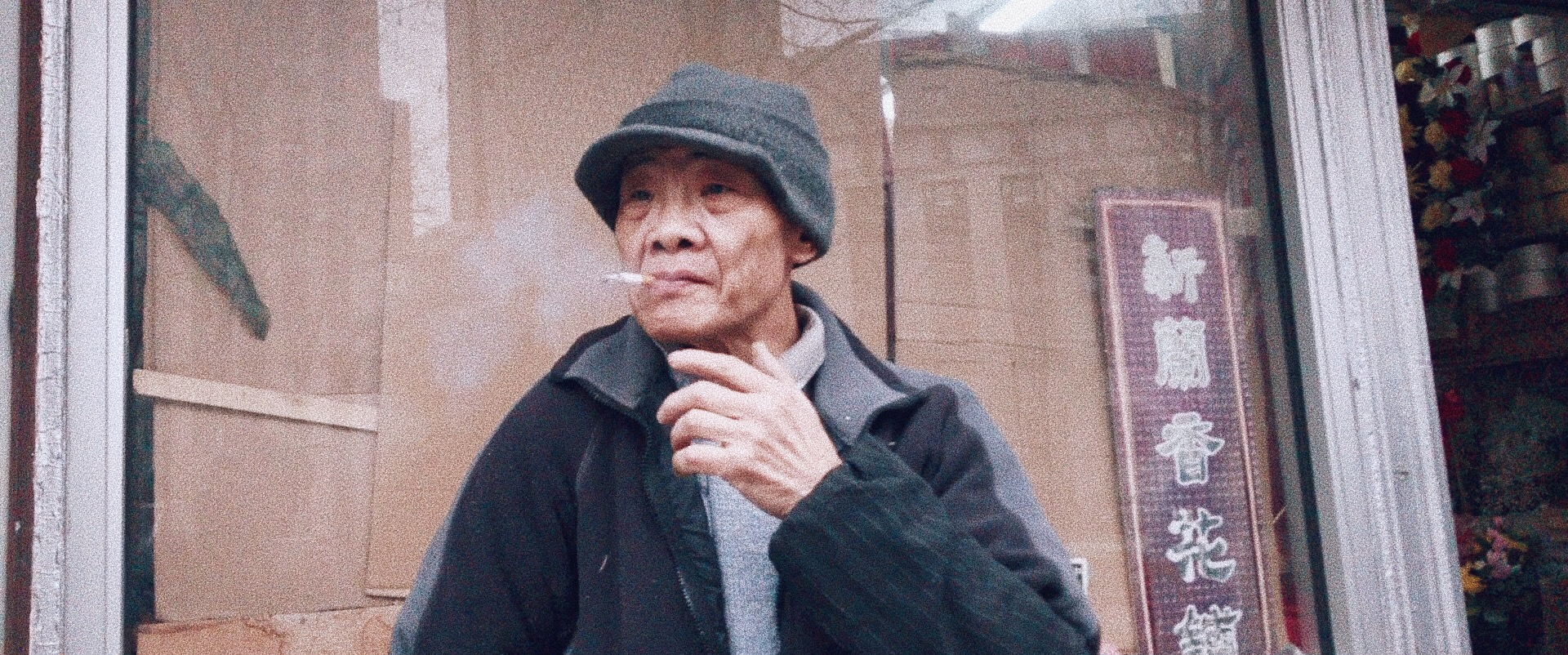 A man smoking a cigarette in Chinatown