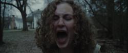 A girl, screaming.