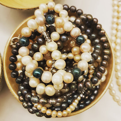 Cultured Pearl's and precious stones - best to be tried on in person.