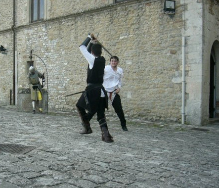 Rare footage of kid Thokk showing fiore in San Leo castle's courtyard.