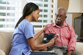 Nurse at home with elderly man